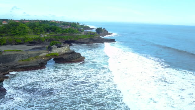 4K : Aerial view by drone footage Pura Tanah Lot Hindu Temple, Tabanan, Bali, Indonesia
