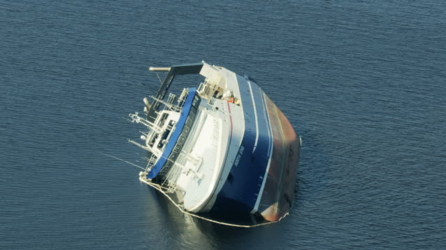 aerial view capsized new alaskan factory trawler florida - saint andrews bay stock-videos und b-roll-filmmaterial