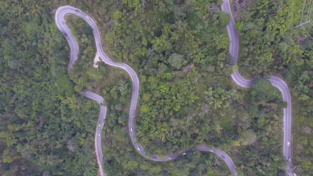Aerial view cars driving along the  winding road on mountain