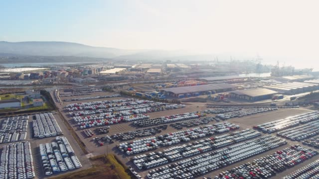 ws aerial view cars parked outside port warehouse,slovenia - car plant stock videos & royalty-free footage