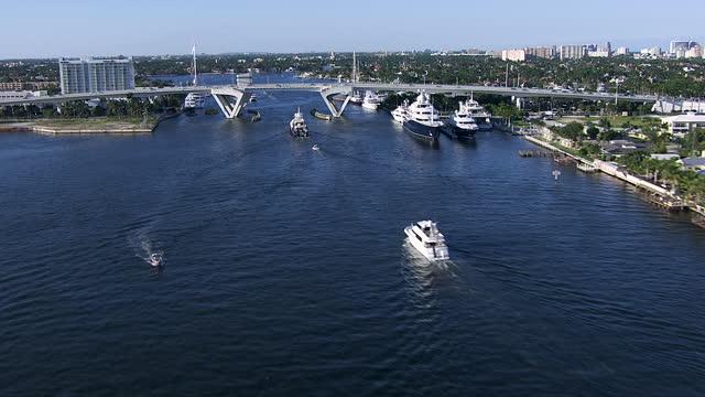 aerial view causeway bridge yachts harbor beach florida - bascule bridge stock videos & royalty-free footage