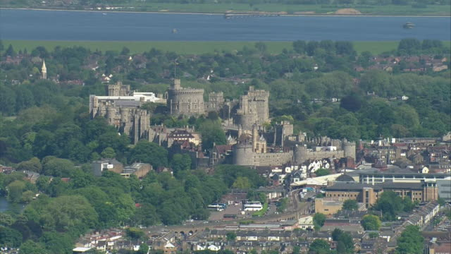 aerial view circling and zooming out of windsor castle during the rehearsal for the wedding of prince harry and meghan markle - schlossgebäude stock-videos und b-roll-filmmaterial