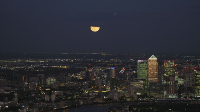 aerial view city lights london skyline at night - canary wharf stock videos & royalty-free footage