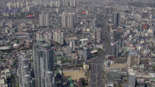 aerial view cityscape of daegu with moving traffic - daegu stock videos and b-roll footage