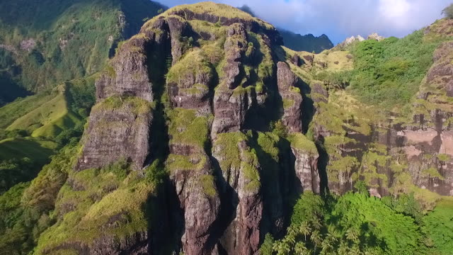 aerial view climbing over fatu hiva volcanic landscape - french polynesia stock videos & royalty-free footage