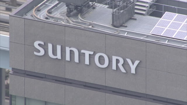 Aerial view Closeup shot of the company logo on the Suntory Holdings Limited building Suntory World Headquarters locates