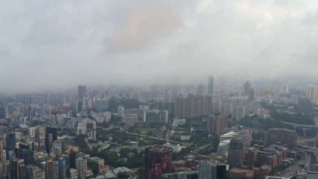 aerial view cloud storm residential  cityscape in hong kong china - sezione superiore video stock e b–roll
