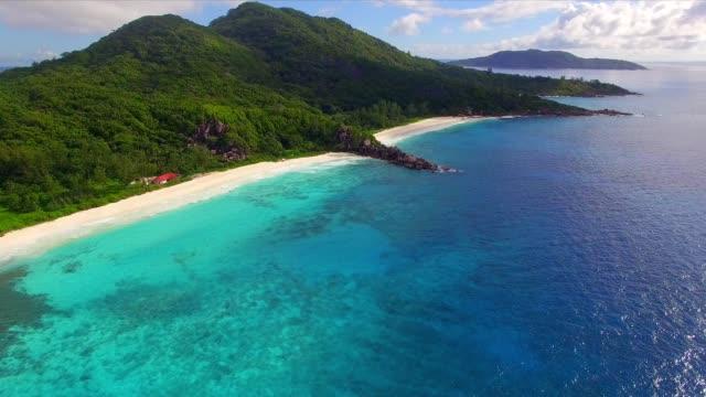 aerial view: coastline of la digue island, seychelles - seychelles stock videos & royalty-free footage