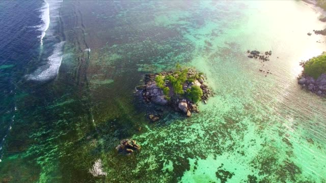 Aerial view: coastline of Mahé Island, Seychelles at sunset