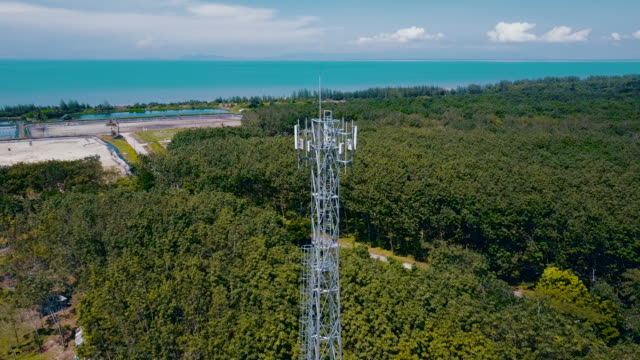 4k aerial view : communication tower - repeater tower stock videos and b-roll footage