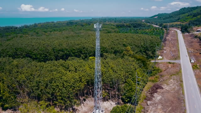4k aerial view : communication tower - telegraph pole stock videos and b-roll footage