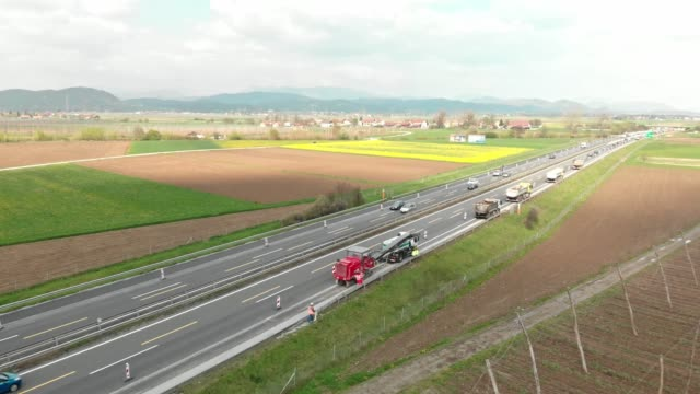 aerial view - construction on the highway - paving stone stock videos & royalty-free footage