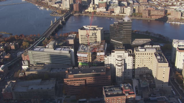aerial view construction site of massachusetts general hospital with cityscape, boston, massachusetts, united states of america - massachusetts stock videos & royalty-free footage