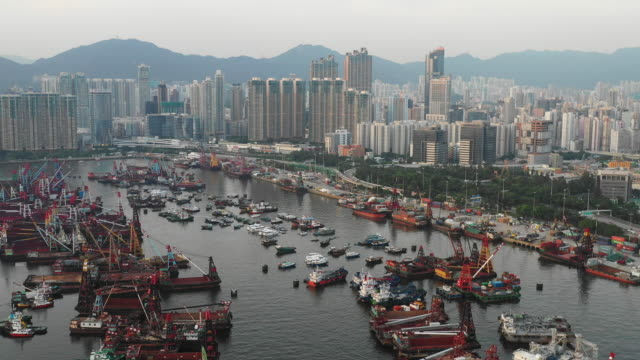 aerial  view container cargo freight ship terminal in hong kong - docks stock videos & royalty-free footage