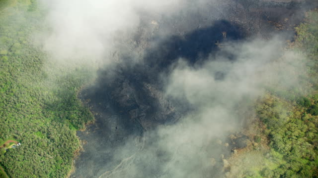 aerial view cooling volcanic lava flowing from volcano - kilauea stock videos & royalty-free footage