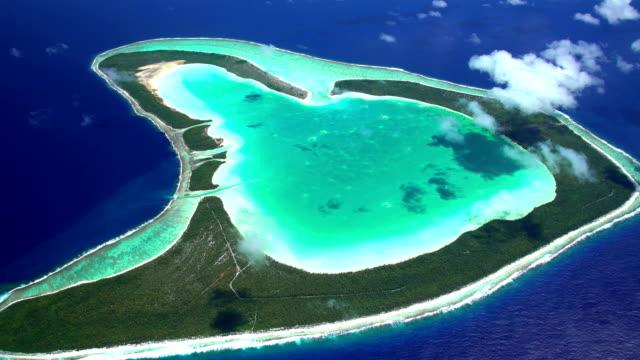 aerial view coral atoll reef tupai french polynesia - french polynesia stock videos & royalty-free footage