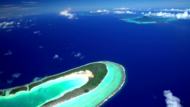 aerial view coral atoll reef tupai heart island - isola di tahaa video stock e b–roll
