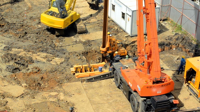 aerial view : crane truck is built steel stake - construction vehicle stock videos & royalty-free footage
