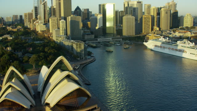 aerial view cruise ship by sydney opera house - opera house stock videos & royalty-free footage