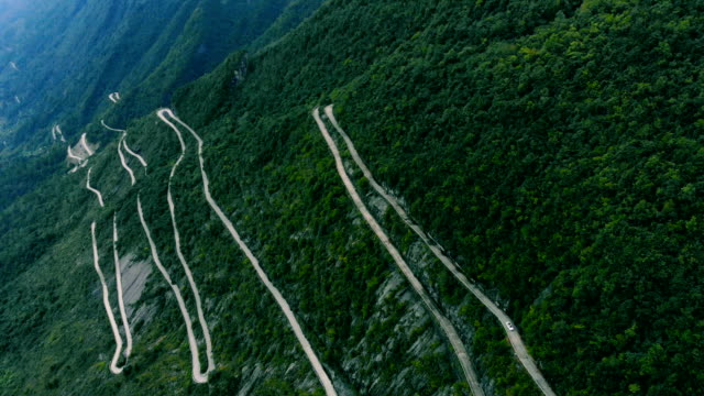 aerial view curve mountain road - lush stock videos & royalty-free footage