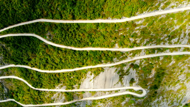 aerial view curve mountain road - winding road stock videos & royalty-free footage