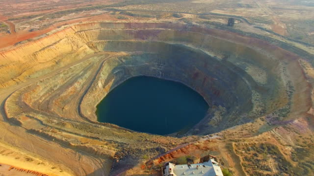 aerial view day dawn gold mine in the australian outback - open cast mine stock videos & royalty-free footage