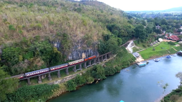 aerial view death railway bridge over the kwai noi river at krasae cave in kanchanaburi province - railway track stock videos & royalty-free footage