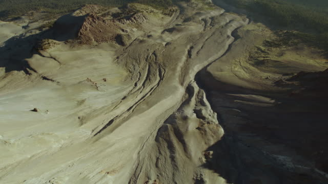 Aerial view descending the northeast face of Mount Lassen over Devastated Area, an area largely devoid of vegetation since Mount Lassen's 1915 eruption.