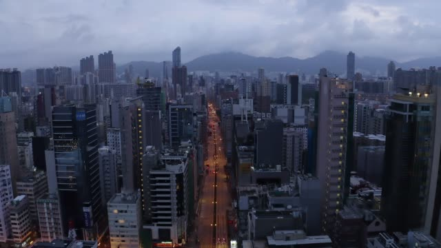 stockvideo's en b-roll-footage met aerial view drone 4k footage of modern skyscrapers in hong kong city. - hong kong
