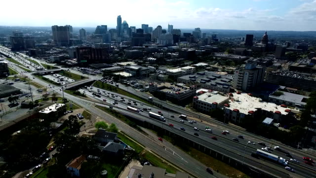 Aerial View Drone Filming Traffic on Interstate 35 or i35 Austin Texas Central Texas Capital Cities Skyline Cityscape 2016