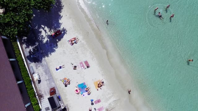 aerial view drone footage of the coastline and tourist koh chang beach top view. - koh chang stock videos and b-roll footage