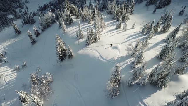 aerial view drone freerider snowboarder drop in powder snow