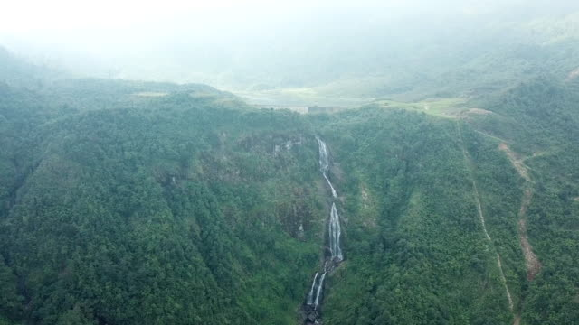 aerial view drone of silver waterfall in sapa, vietnam lao cai province - vietnam stock videos & royalty-free footage