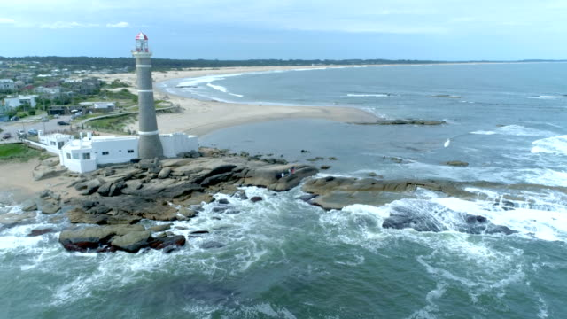 vídeos de stock, filmes e b-roll de aerial view, drone point of view of la paloma lighthouse, uruguay - uruguai