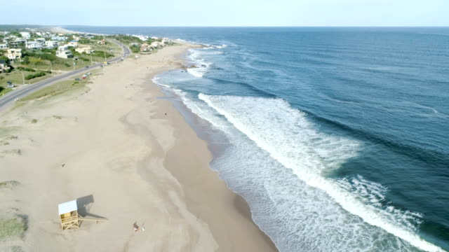 aerial view, drone point of view, punta del este's beach, sand and ocean, uruguay - tranquillising stock videos & royalty-free footage