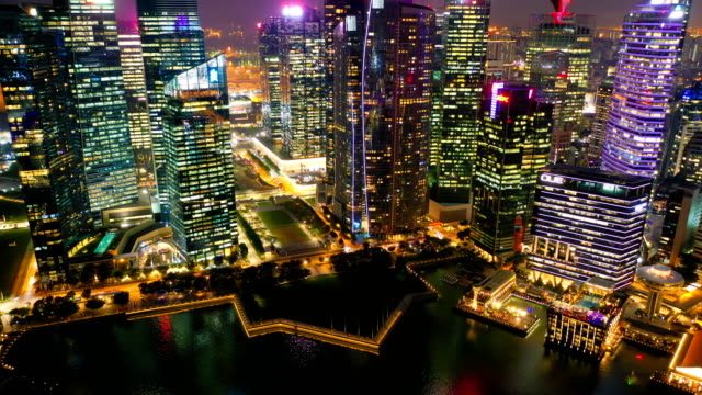 aerial view dronelapse or hyperlapse of financial central business district building of singapore city at night - singapore stock videos & royalty-free footage