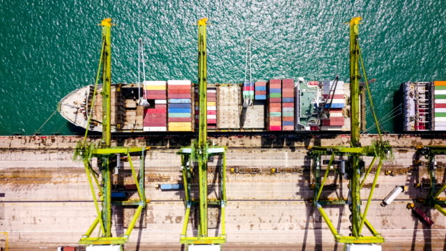 vídeos de stock e filmes b-roll de aerial view drone-lapse or time-lapse of industrial port with containers ship in singapore - transporte de mercadoria