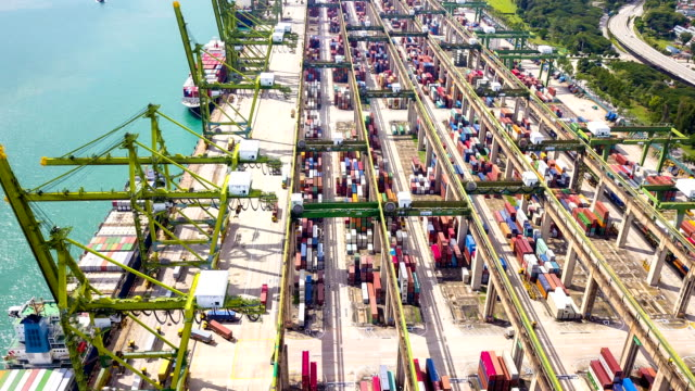 aerial view drone-lapse or time-lapse of industrial port with containers ship in singapore - molo video stock e b–roll