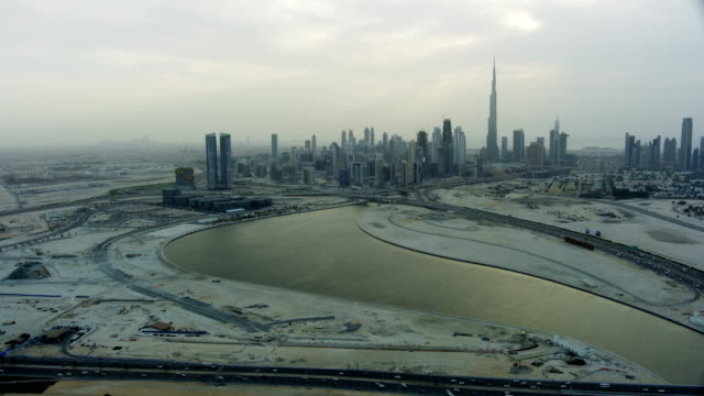 aerial view dubai canal footbridge city desert coastline - irrigation equipment stock videos and b-roll footage