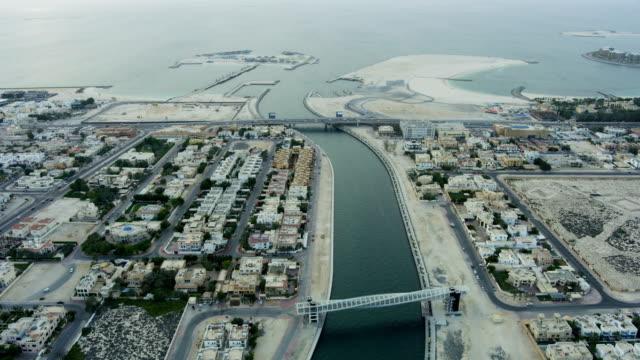aerial view dubai canal footbridge city desert coastline - irrigation equipment stock videos & royalty-free footage