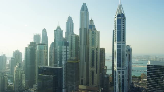 stockvideo's en b-roll-footage met aerial view dubai marina dubai creek skyscrapers uae - perzische golf