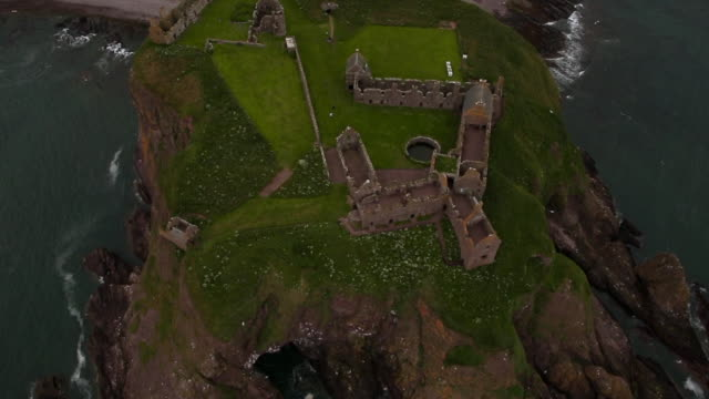Aerial View Dunnottar Castle Ruins on Grassy Headland
