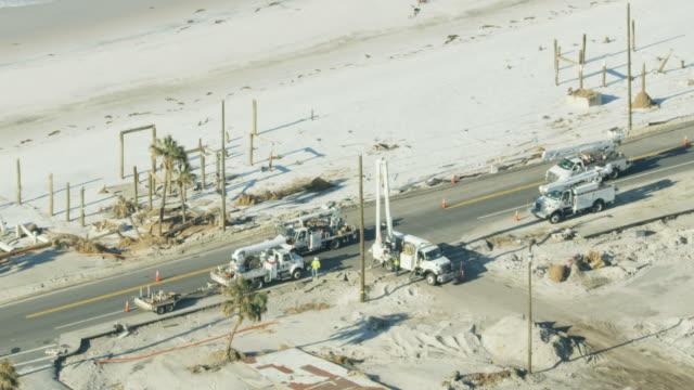 aerial view emergency utility trucks workmen mexico beach - 2018 stock videos & royalty-free footage