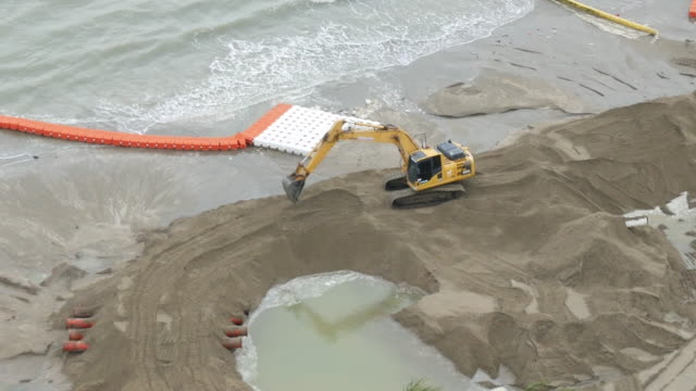 Aerial view Excavator is improving the beach to protect the sea.