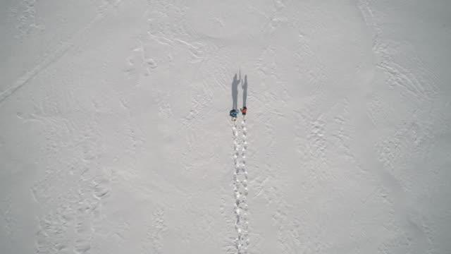 aerial view family snowshoeing outdoor in winter - footprint stock videos & royalty-free footage