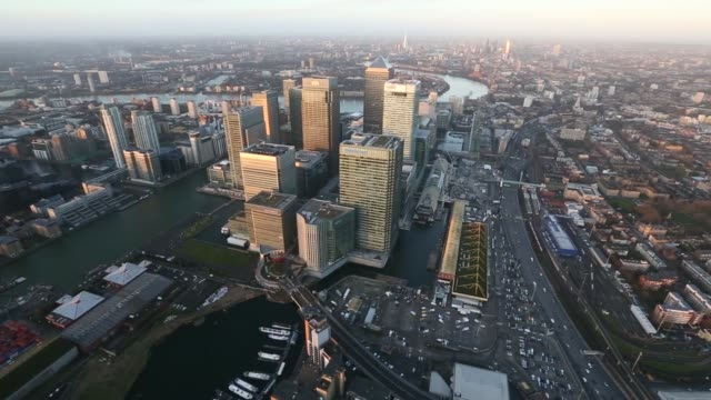 Aerial view filmed at sunrise shows No 1 Canada Square stands surrounded by the offices of global financial institutions including HSBC Holdings Plc...