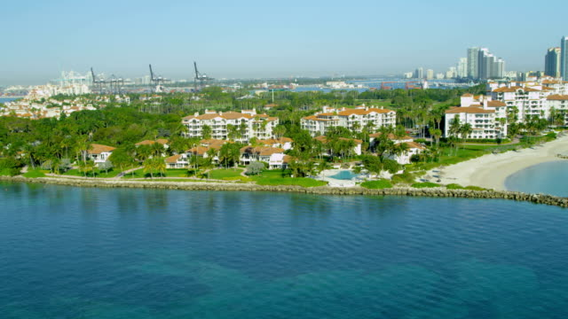 aerial view fisher island luxury apartments miami florida - biscayne bay stock videos and b-roll footage