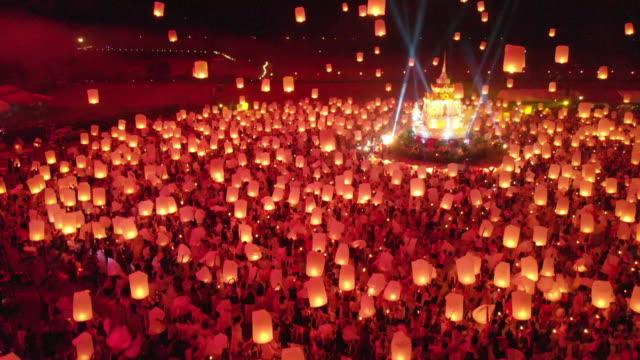 4k aerial view floating sky lantern in chiang mai thailand - sky lantern stock videos & royalty-free footage