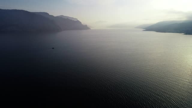 aerial view, flying along beautiful landscape of fjords, mountain hills rising up from the water surface, seascape, sunrise-dawn, beauty in nature, travel destinations, adventure, travel, exploration, sun, fishermen, fishing - fisherman stock videos & royalty-free footage