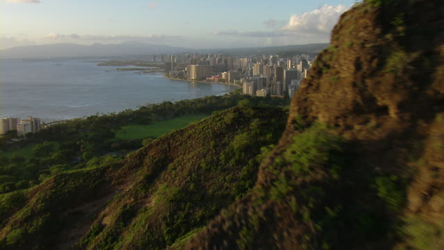 aerial view flying around diamond head revealing skyline of honolulu, hawaii. - pacific islands stock videos & royalty-free footage